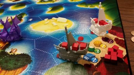 A fully loaded merchant ship docked at port.